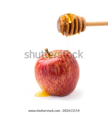 Apple and honey on wooden stick for jewish new year celebration