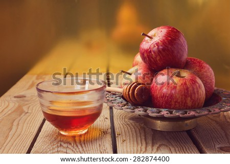 Apple and honey over golden background. Jewish Rosh hashana (new year) celebration - stock photo