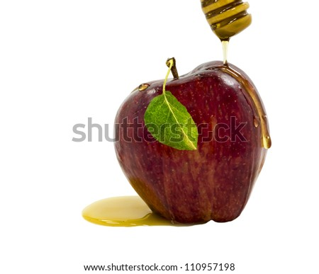 Apple and honey running down on white background - stock photo