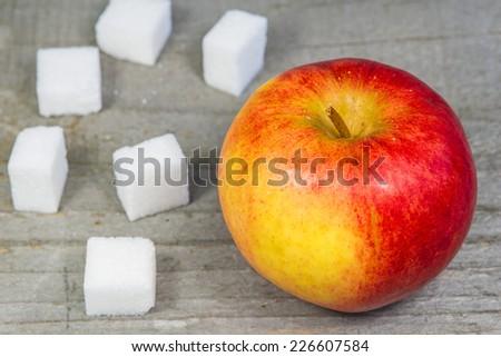 apple and lump sugar - stock photo