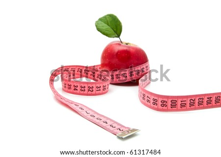 apple and meter on a white background - stock photo