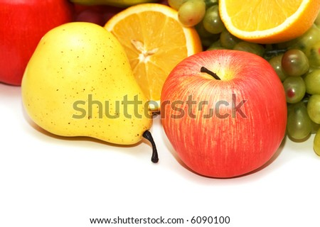Apple and pear and other fruits  at background - more similar photos in my portfolio - stock photo