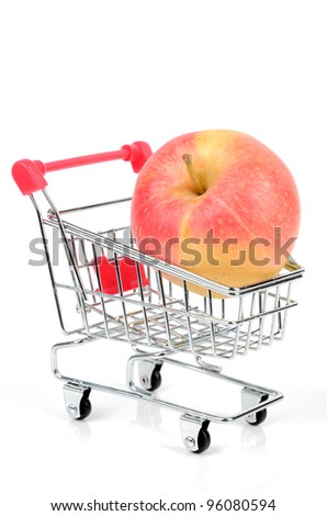 Apple and shopping cart - stock photo