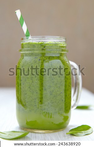 Apple and spinach green smoothie in mason jar - stock photo