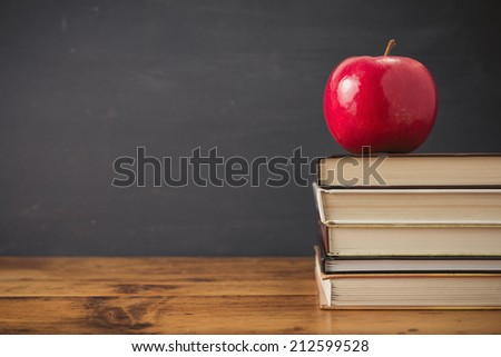 Apple and stack of books - stock photo