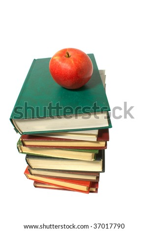 apple and stack of books isolated on white background