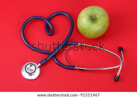 apple and stetoskop - stock photo