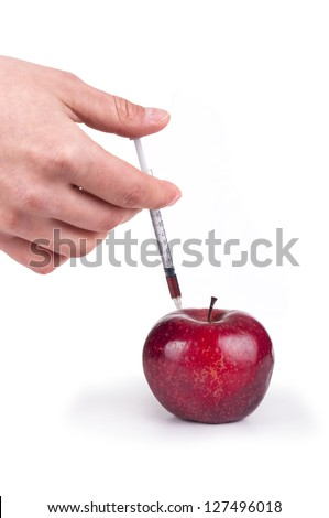 Apple and syringe in hand - stock photo
