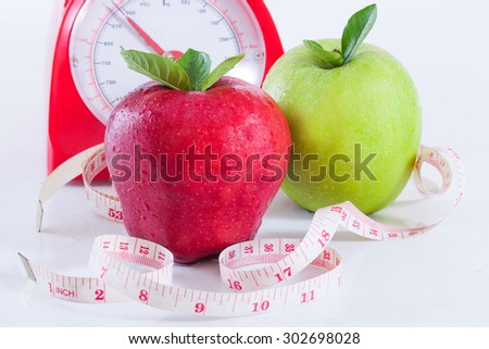 Apple and weights with measuring tape
