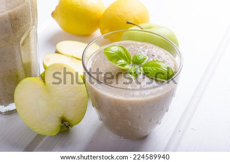 Apple, banana smoothie with basil, fresh fruits - stock photo