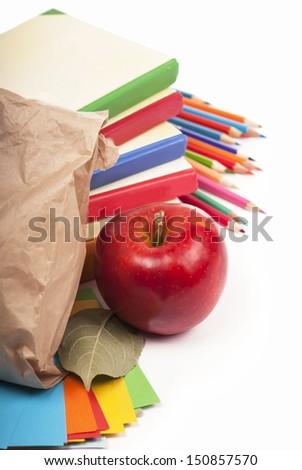 apple, board, books, pencils, opened empty notebook - stock photo