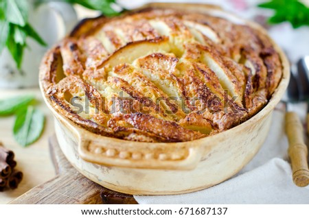Apple cake with cinnamon on a wooden table