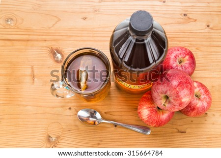Apple cider vinegar with brewed tea, natural remedies and cures for common health condition - stock photo