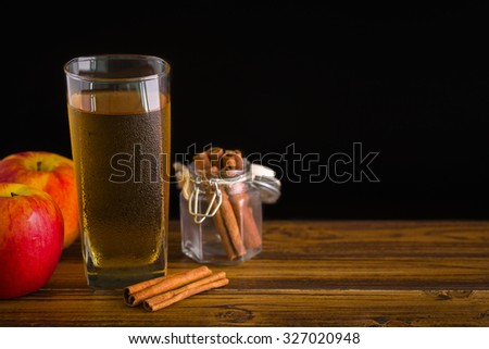Apple Cider with Cinnamon Background / Apple Cider / Apple Cider with Cinnamon on Black Background - stock photo