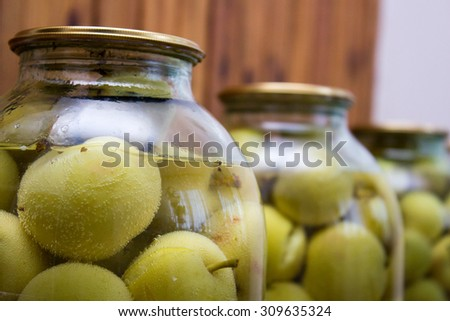 apple compote in a decanter on a background of green apples - stock photo