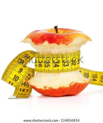 apple core and measuring tape. Diet concept - stock photo