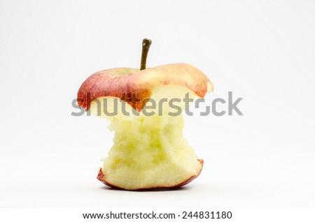apple core (focus on stalk) - stock photo