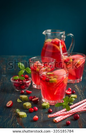 Apple, cranberry and rhubarb drink, selective focus - stock photo