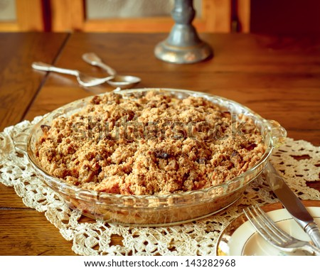 Apple crumb crisp pie in country setting - stock photo
