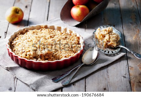 Apple crumble on the wooden background with apples  - stock photo