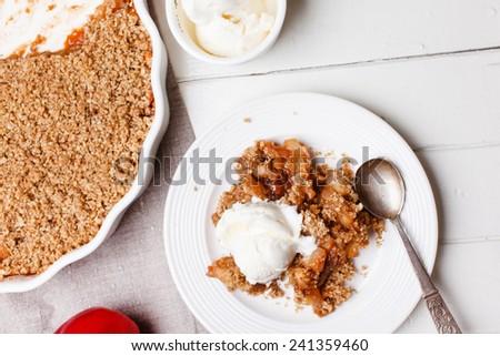 apple crumble with ice cream - stock photo