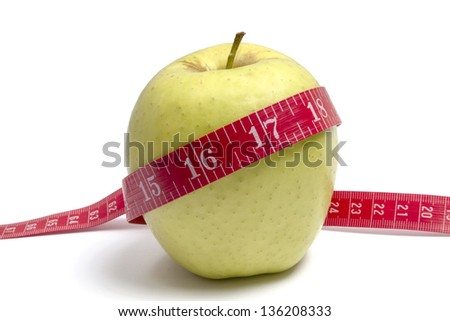 Apple diet.Green apple and tape measure