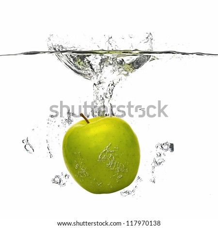 apple falling into the water with splash on white - stock photo