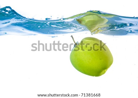 Apple fell into the water. Close-up. Isolated on white.