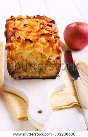 Apple filling and apple topping tea cake on board