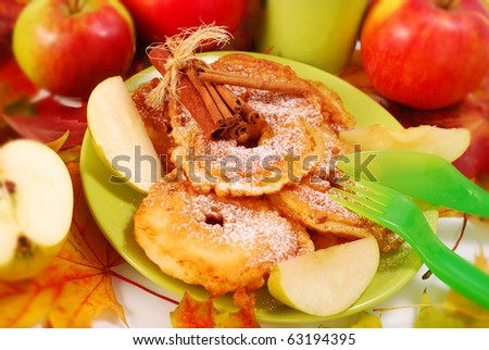 apple fritters with icing sugar and cinnamon fried on pan for child - stock photo