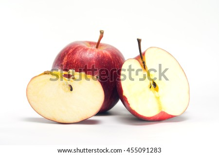 Apple fruit (also known as Malus, domestica, pomaceous fruit) close-up view with half cross section isolated on white background