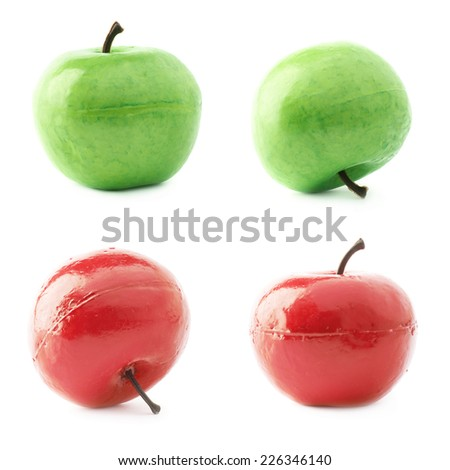 Apple fruit artificial plastic decoration isolated over the white background, set of four images of the red and green objects - stock photo