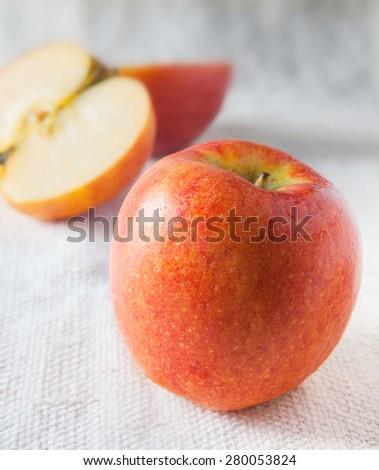 Apple fruit closeup on cotton fabric white background - stock photo