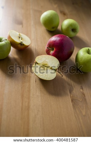 Apple fruits on wooden background in natural light. Selective focus