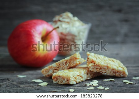 Apple granola barre with fruits and oat in background - stock photo
