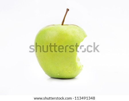 apple green bitten off - stock photo