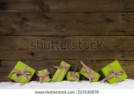 Apple green christmas presents on wooden background for a gift certificate. - stock photo