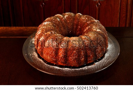 Apple honey cake to serve during the high holidays made with vegetable oil instead of butter and lightly sprinkled with icing sugar