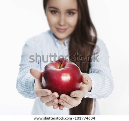 apple in a hand of a smiling girl
