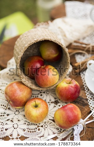 apple in basket on table - stock photo