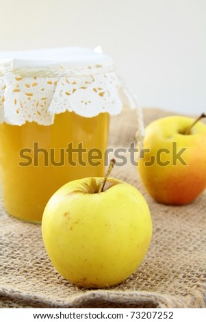 apple jam in a glass jar on the table - stock photo