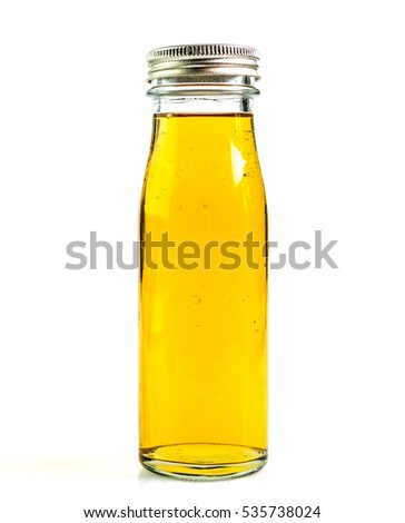 Apple juice a bottle on a white background.