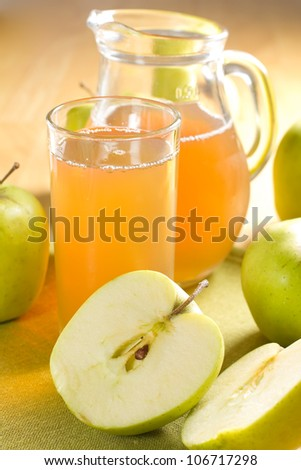 Apple juice and fresh fruits with leaves - stock photo