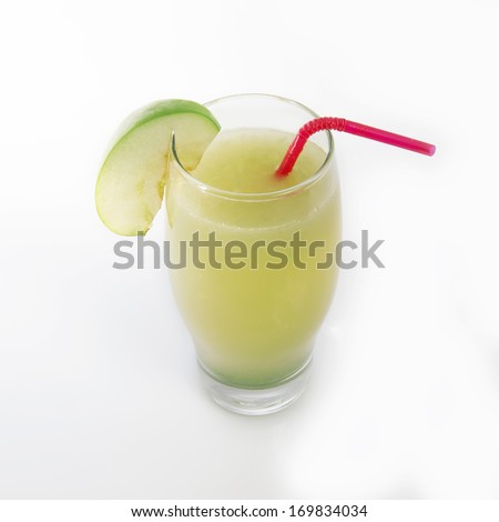 Apple juice and slices of Apple with red straw isolated on white  - stock photo