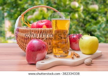Apple juice - beverage on wooden table. - stock photo