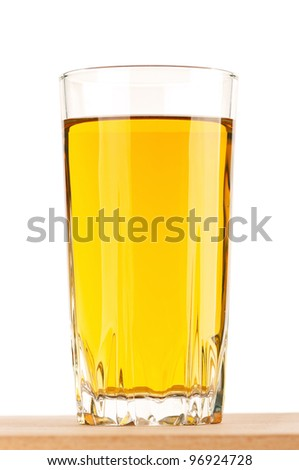 Apple juice in glass on wooden board over white background