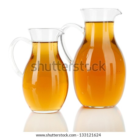 Apple juice in pitchers isolated on white - stock photo