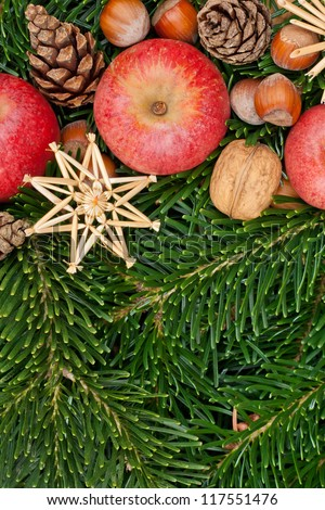 apple, nuts, stars, pine cones and fir branches/christmas decorations/christmas