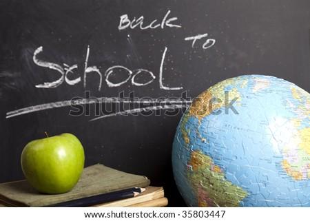 Apple on a blackboard - stock photo