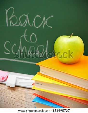 Apple on books. Against a school board. Back to school.